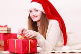 Happy woman make christmas presents - 229579121