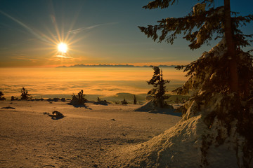 Sunrise on the top of the Babia mountain with the Tatras background