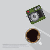 Coffee cup and camera vintage top view table