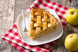 Homemade apple pie slice on wooden table