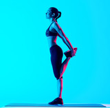 one mixed races woman exercsing stretching fitness exercices isolated on blue blackground - 229607533