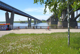 View of the bridge on a summer day from the right Bank of the Ob river in Novosibirsk