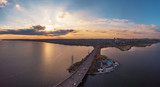 Aerial view of Vograsovsky bridge with car traffic connecting Left Bank and Leninsky districts of Voronezh, panoramic view at sunset