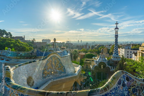 Leinwandbild Motiv City view with a clear blue sky from the top of Park Guell in Barcelona. Park Guell is one of the famous architect Antoni Gaudi's major works. It is among the most popular tourist attractions.