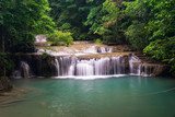 The stunning and beautiful Erawan waterfalls near Kanchanaburi located a little north west of Bangkok in Thailand.