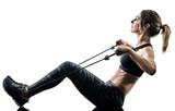 one caucasian woman exercising pilates fitness elastic resistant band exercises isolated silhouette on white background - 229616769
