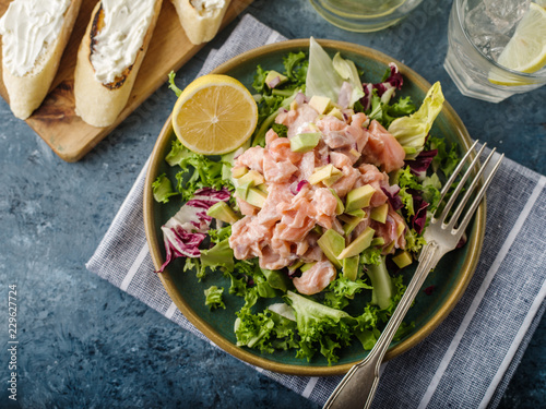 Ceviche is a traditional dish from Peru. Salmon marinated in lemon with fresh lettuce, avocado and onions - 229627724