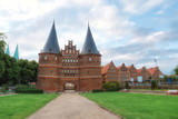 Historical Holstentor City Gate. View at cloudy day - 229630545