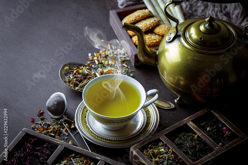 Tea in a cup on an old background © Karnav