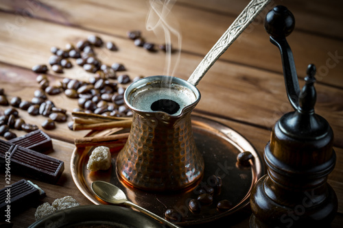 Poster Black coffee on old background