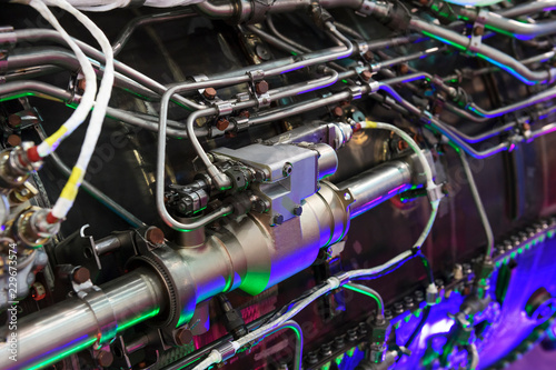 fototapeta na ścianę Engine of fighter jet, internal structure with hydraulic, fuel pipes and other hardware and equipment, army aviation, military aircraft and aerospace industry