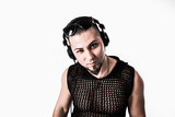 portrait of a stylish DJ with headphones on a white background - 229686747