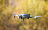 The drone copter flying with digital camera. - 229688369