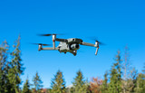 The drone copter flying with digital camera. - 229688370