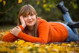 Happy teenage girl portrait in autumnal scenery - 229705399