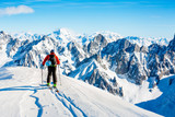 Skitouring with amazing view of swiss famous mountains in beautiful winter powder snow of Alps.  - 229705996