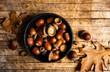 Leinwanddruck Bild - Acorns on a rustic wooden table