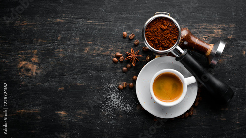 Poster Espresso coffee On a wooden background. Top view. Free copy space.
