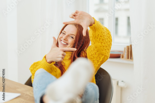 Woman making a frame gesture with her fingers
