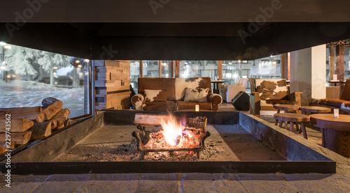 Leinwanddruck Bild Interior of restaurant view from fireplace