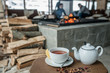 Cup of tea teapot on wood table in restaurant and fireplace is back - 229744131