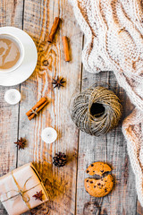 Christmas muffler with cup of cocoa wooden background top view