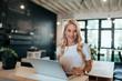 Portrait of successful businesswoman in modern office.