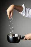chef woman sprinkle salt cooking prepare food seasoning on grey background