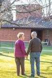 Happy elderly couple walking in the garden - 229756546