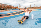 Man in 40s is stretching before jogging at city park - 229756554