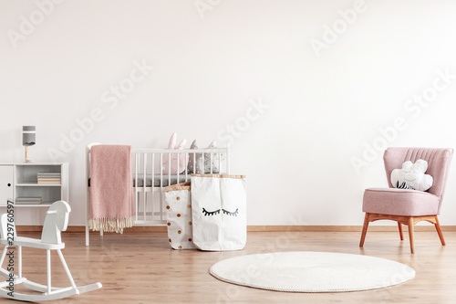 Bright Scandinavian Baby Room With Rocking Horse White Nursery And Pink Armchairs Posters On