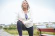 Leinwanddruck Bild -  Senior woman stretching outdoors before running