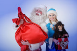 snow maiden with Santa Claus holding Christmas gifts