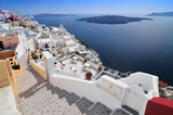 Afternoon view over town and ocean at Fira Thira Santorini Island Greece.