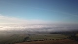 Exceptional aerial over a cloudy countryside - 229828528