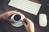 woman hand computer keyboard with coffee