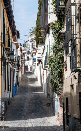 Sloping street in the Spanish city of Granada - 229864916
