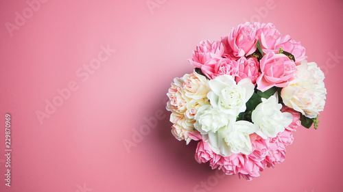 Rose flowers are on a pink background. Valentines Day Background. - 229870969