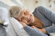 Senior woman resting on bed