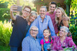 during a bbq a teenager does a selfie with the whole family - 229893783
