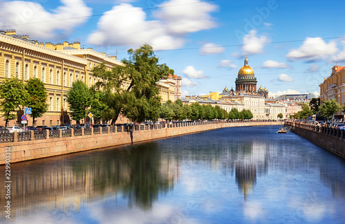 Leinwanddruck Bild Saint Isaac Cathedral across Moyka river, St Petersburg, Russia