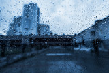 abstract texture - water drops on glass, city on the background