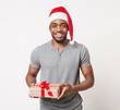 Happy black man holding christmas gift box