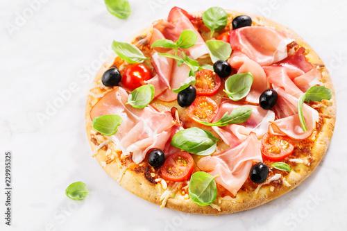 Leinwanddruck Bild Tasty fresh baked pizza on marble table