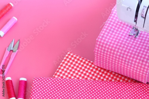 Electric sewing machine and accessory set isolated on pink background - 229940770