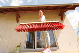 Woman cleaning patio using brush broom - 229944711