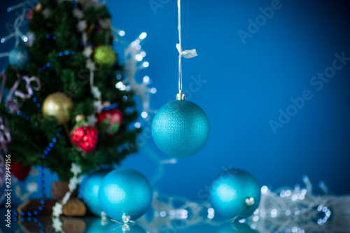 Christmas toys with a Christmas tree on a blue background