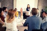 Female raises hand for discussion - 229997107
