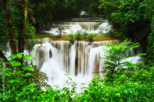 giant waterfall in complete green forest - 230020354