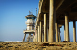 Ocean pier and beach sand - 230022142